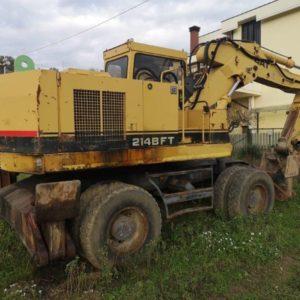 escavatore idraulico gommato caterpillar  bft